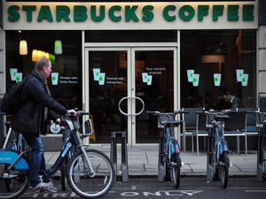 Starbucks says 'will pay more tax' in UK after Europe HQ shift
