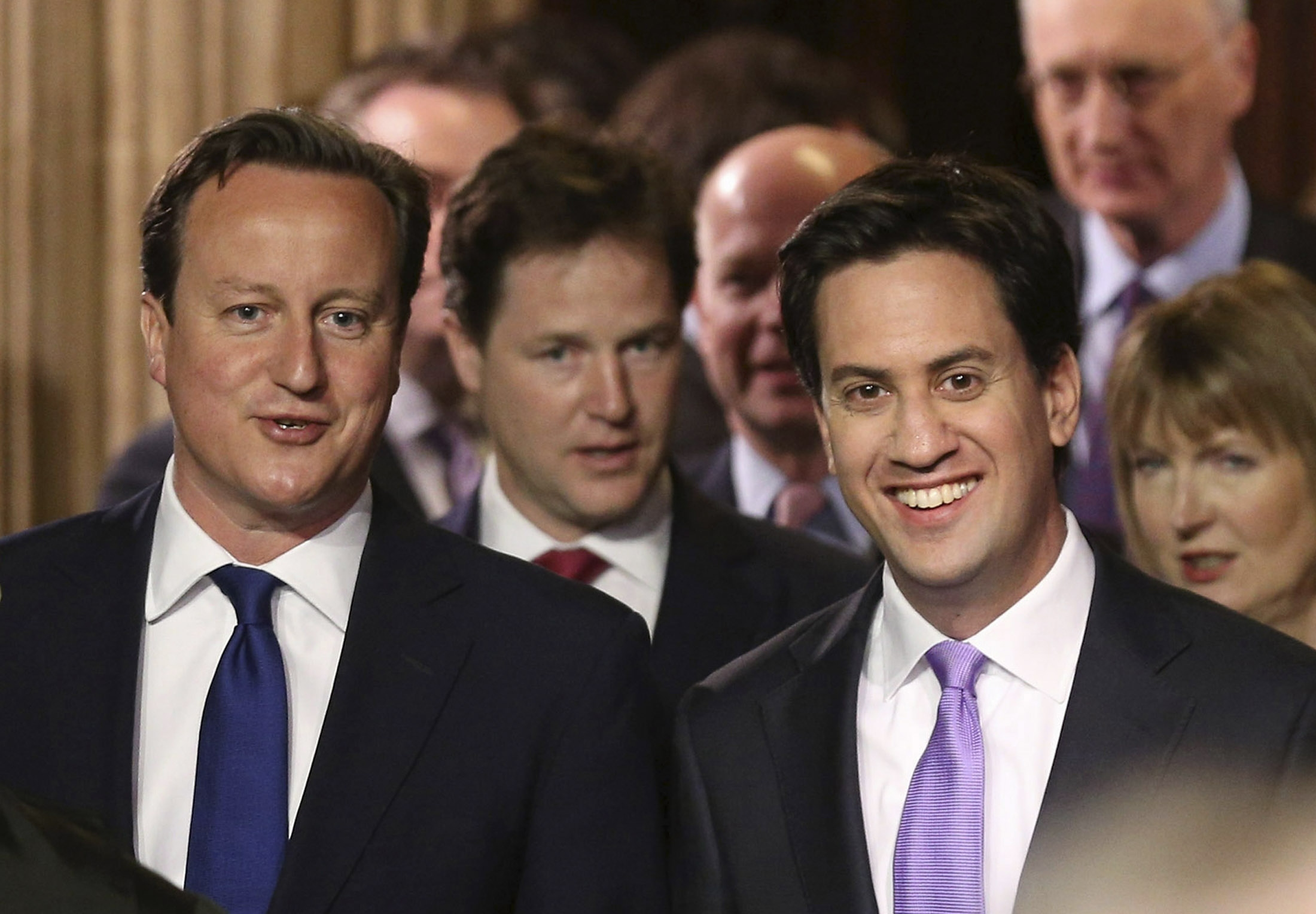 Britain's Prime Minster David Cameron and opposition Labour Party leader Ed Miliband attend the State Opening of Parliament in London