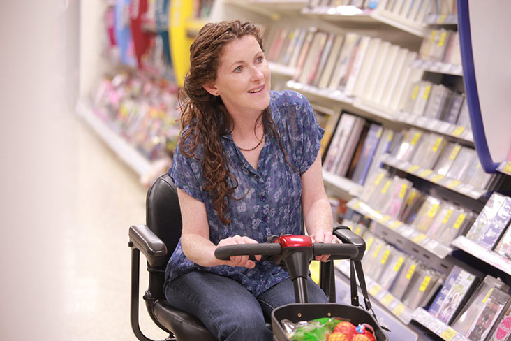Motability Scheme customer in supermarket