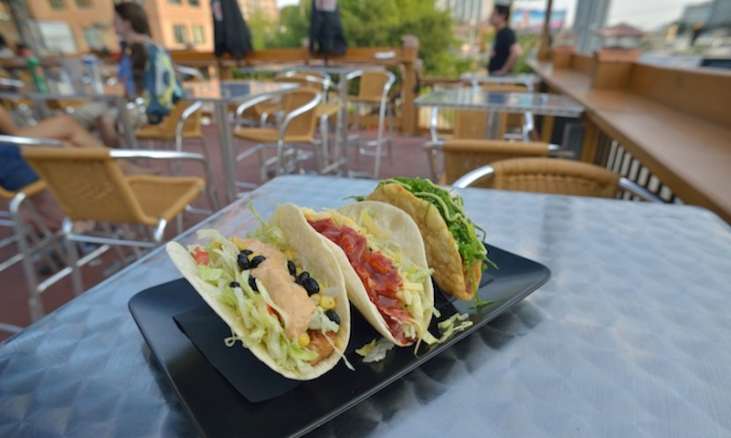 Enjoy gourmet tacos on the rooftop at Rock 'N Taco.