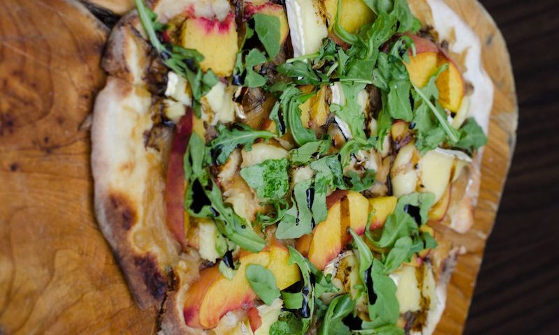Peach flatbread from 5Church in Midtown makes for a terrific light summer meal.