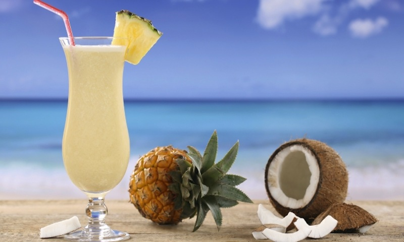 Take a trip to the beach without leaving town, with a piña colada.