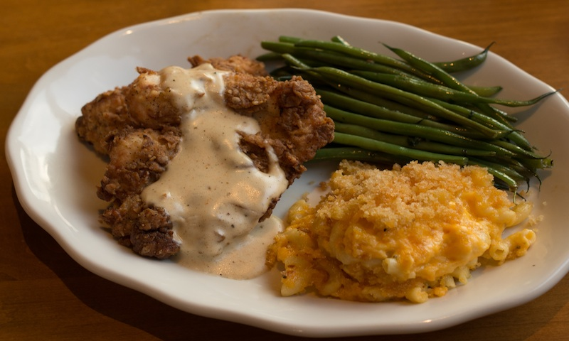 Tupelo Honey Cafe's chicken is topped with creamy gravy and served with Southern favorites.