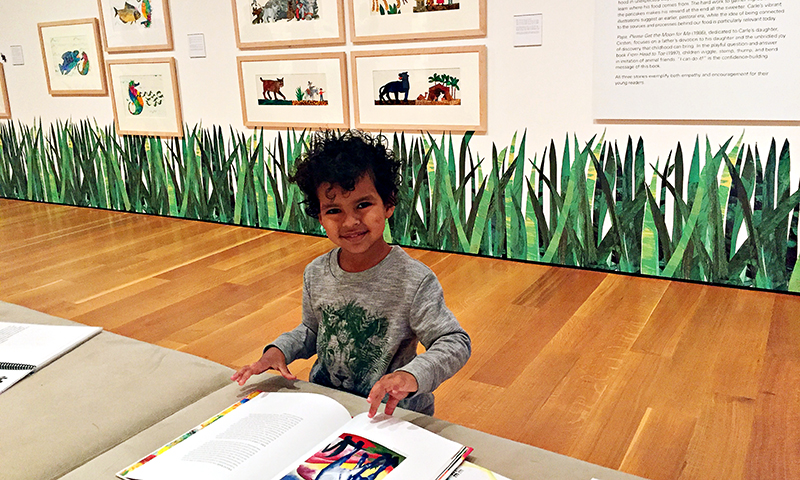 Children can enjoy reading and admiring Carle's work in books throughout the exhibit.