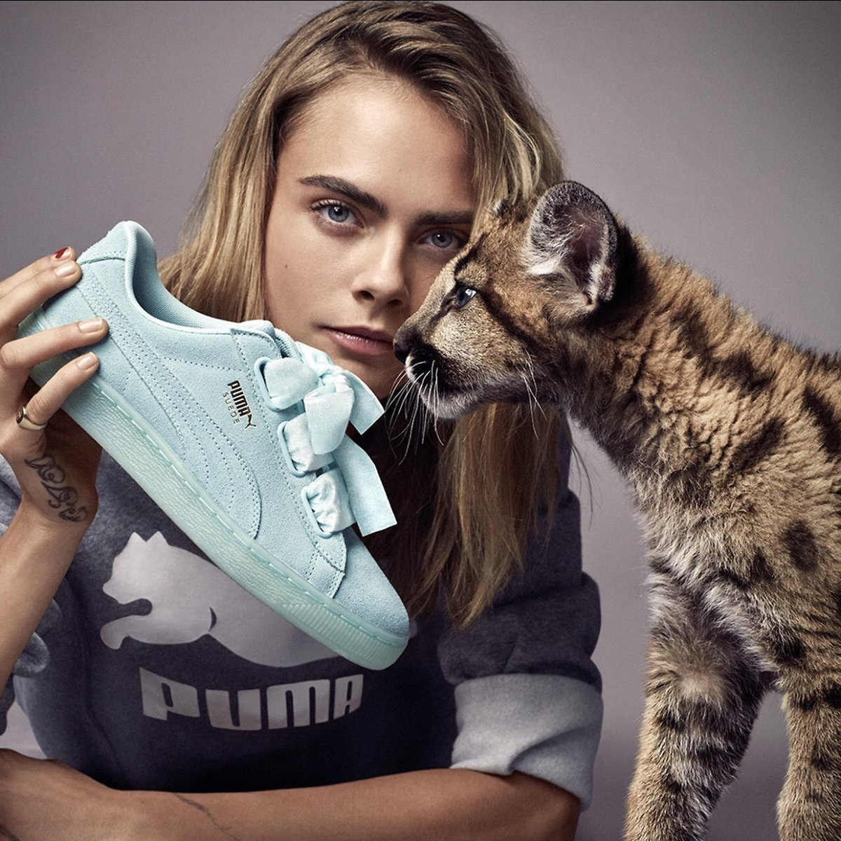 927375752c6 Cara Delevingne Poses with Wild Cats (Again) for PUMA s Spring 2017 Campaign