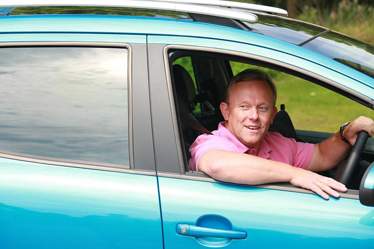 Motability Scheme customer driving Motability Scheme car